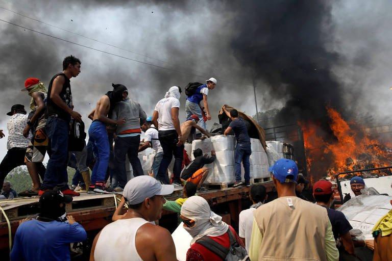 Regime Maduro impede entrada de ajuda e distúrbios deixam mortos e feridos (3)